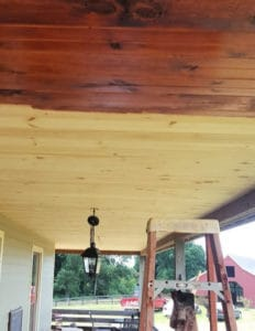 stained porch ceiling in progress
